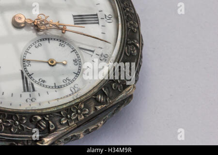 Old pocket watch from 1800 showing hour, minute, second hand. - Stock Photo