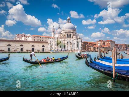 Traditional Gondolas on Canal Grande with historic Basilica di Santa Maria della Salute in the background, Venice, - Stock Photo