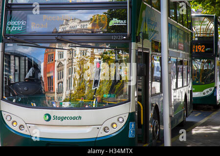 Electric Hybrid Stagecoach bus in traffic Piccadilly, Manchester, UK - Stock Photo