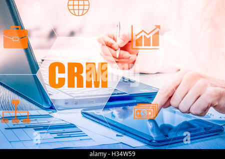 Business, technology, internet and networking concept. Businessman working on his laptop in the office, select the - Stock Photo