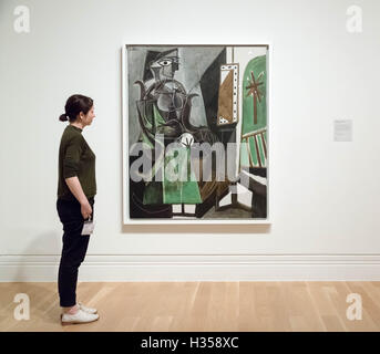 London, UK. 5th October, 2016. Picasso painting ' Woman by a Window' (1956) viewed by a gallery staff member. National - Stock Photo
