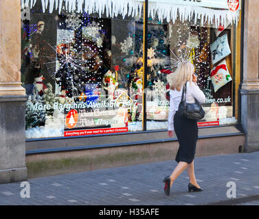 People passing shop windows of business retail fashion stores in the city centre. Liverpool, Merseyside, UK. 5th - Stock Photo