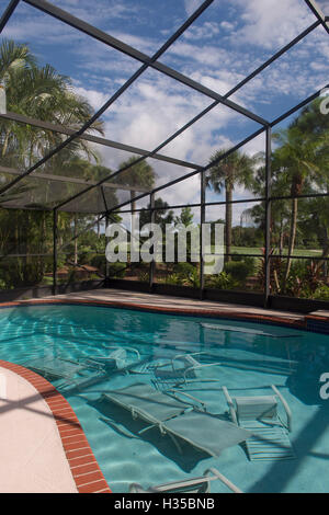 DELRAY BEACH, FL - OCTOBER 05: Despite bright blue skies, residents have begun preparations by tossing furniture - Stock Photo