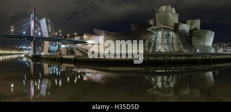 The Guggenheim at night from the other side of the river, Bilbao, Biscay, Basque Country, Spain, Europe - Stock Photo