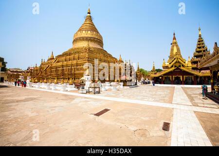 The Shwezigon Pagoda (Shwezigon Paya), a Buddhist temple located in Nyaung-U, a town near Bagan, Myanmar (Burma) - Stock Photo