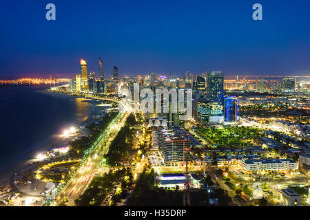 Skyline and Corniche, Al Markaziyah district by night, Abu Dhabi, United Arab Emirates, Middle East - Stock Photo