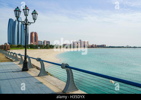 View from the Breakwater towards Etihad Towers and Emirates Palace Hotel and beach, Abu Dhabi, United Arab Emirates, - Stock Photo