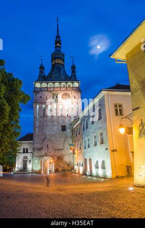 Sighisoara Clock Tower at night in the historic centre of Sighisoara, a 12th century Saxon town, UNESCO, Transylvania, - Stock Photo