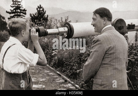 Adolf Hitler at his residence in Obersalzberg, Bavaria, Germany in 1936, watching a boy observing the Unterberg - Stock Photo