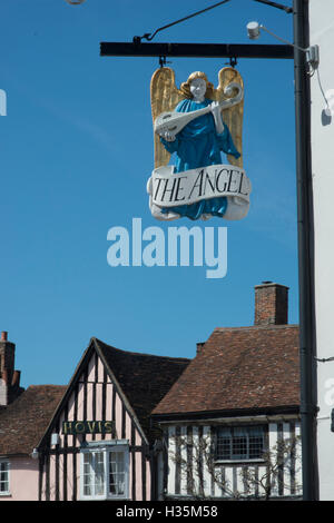 Pub sign over 15th century buildings in the town of Lavenham, once one of the wealthiest in England, Suffolk. - Stock Photo