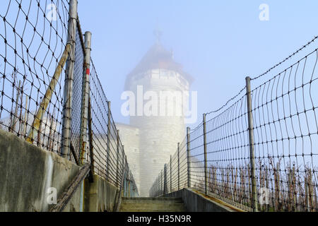 View of the Munot in a foggy winter day, in Schaffhausen, Switzerland - Stock Photo