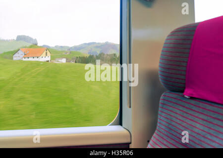 Swiss countryside landscape view from a train, in the Appenzell canton, Switzerland - Stock Photo