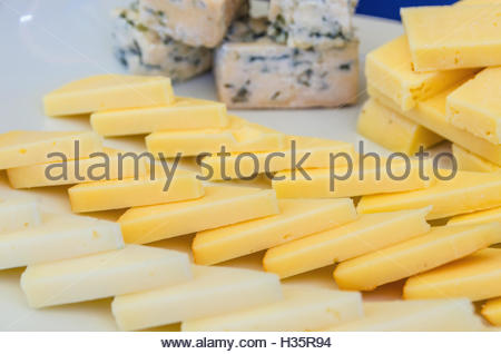 dish with pieces of assorted Asturian cheeses cut into triangles or blocks - Stock Photo