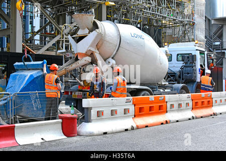 Temporary part road closure City of London to facilitate park & unload of concrete delivery trucks at construction - Stock Photo