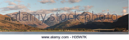 Mountain panoramic view from Loch Linnhe looking over to North Ballachulish and the Ballachulish bridge. - Stock Photo