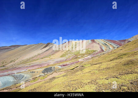 Along the hike up to the Rainbow Mountain near Cusco Peru. Not less colorful. Located about 20km south of Ausangate - Stock Photo
