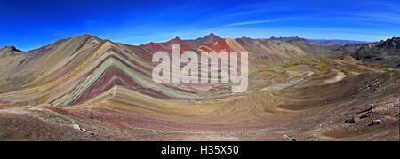 The total panorama of the beautiful colored Rainbow Mountain, near Cusco in the peruvian mountains. Located about - Stock Photo