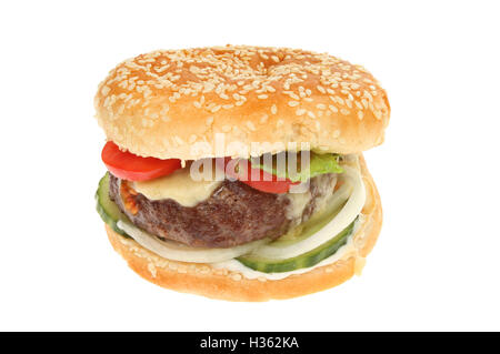 Cheeseburger with salad garnish in a sesame seeded bun isolated against white - Stock Photo