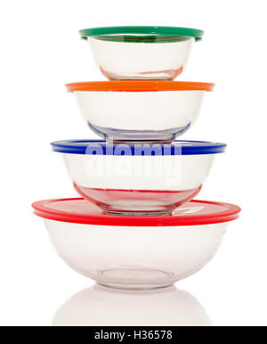 Stacked clear glass bowls on an isolated background - Stock Photo