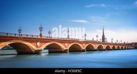 Pont de Pierre bridge with St Michel cathedral, Bordeaux, France - Stock Photo