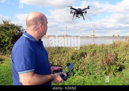 Man flying 3DR RTF X8 drone near River Mersey, Merseyside, England - Stock Photo