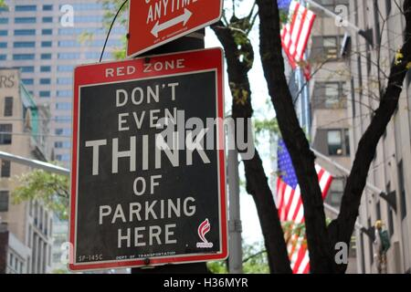 'Don't even think of parking here' street sign displayed on 5th Avenue in Midtown Manhattan on August 31st, 2016 - Stock Photo