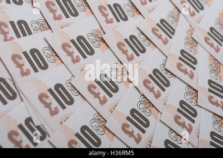 Fanned out £10 banknotes - as visual metaphor for concept of UK currency, wages, disposable income, economy and - Stock Photo