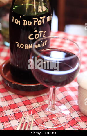 A bottle of house wine on the table of Roi du Pot au feu,the traditional French beef stew restaurant.Paris.France - Stock Photo