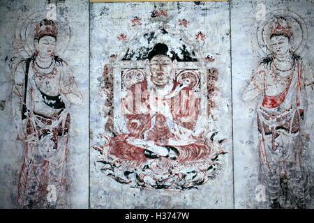 An antique Japanese Buddha mural display in Galeries du Pantheon bouddhique of Museum Guimet Paris. France - Stock Photo
