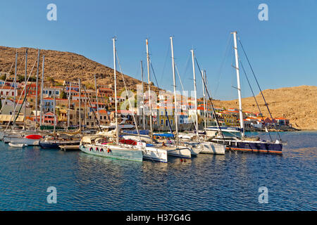 Small marina and pontoons in Chalki, Island of Chalki, Dodecanese Islands,Greece. - Stock Photo