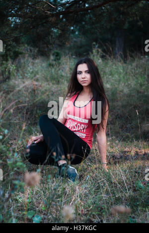 Young beautiful brunette in the park - Stock Photo