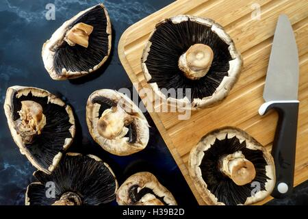 Fresh mushrooms on chopping board - Stock Photo