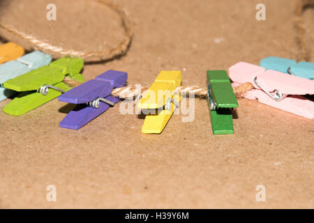 Colorful wooden clothespin. Background of colorful clothes pegs. Closeup of colorful clothespins. - Stock Photo