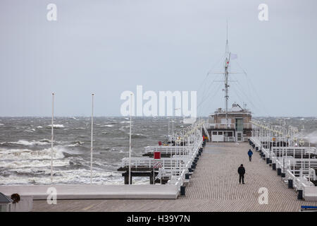 Big waves destroy the wooden pier in Sopot, Poland. - Stock Photo