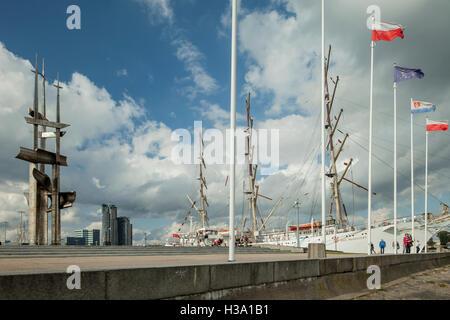Kosciuszko Square in Gdynia, Poland. Dar Mlodziezy sail ship in the distance. - Stock Photo