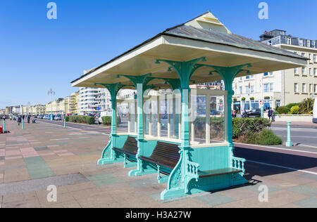 Old style seafront shelter on the promenade at Brighton, East Sussex, England, UK. - Stock Photo