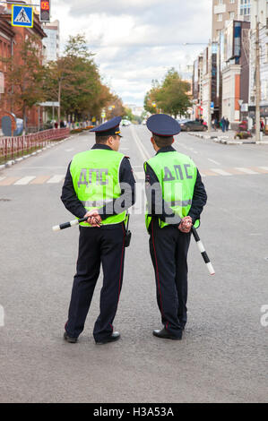 Russian police patrol officers of the State Automobile Inspectorate regulate traffic