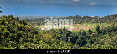 Indonesia, Lombok, Senaru, panoramic view of north coast and irrigated farmland on slopes of Gunung Rinjani - Stock Photo