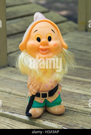 Old rubber toy in form of a bearded gnome for young children - Stock Photo