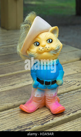 Old rubber toy in form of a Puss in Boots for young children - Stock Photo