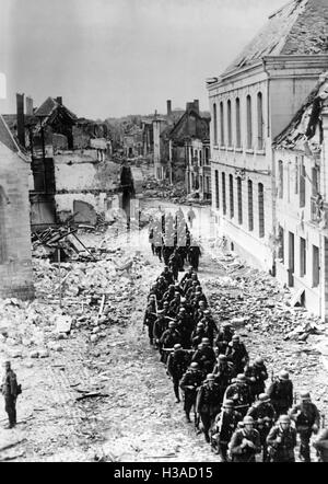 German infantry marching through a French town, 1940 - Stock Photo