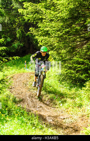 Rider participating in Pass'Portes du Soleil MTB 2016 a mountain bike event across the French-Swiss border - Stock Photo