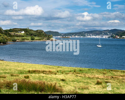 View over the Sound of Kerrera to Oban from Horseshoe Bay on the Isle of Kerrera Argyll and Bute Scotland - Stock Photo