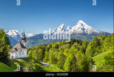 Idyllic mountain scenery in the Alps with pilgrimage church of Maria Gern and Watzmann mountain in springtime, Bavaria, - Stock Photo