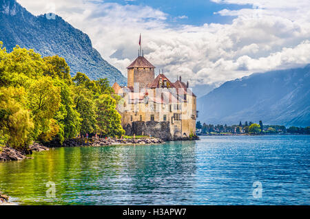 Classic view of famous Chateau de Chillon at Lake Geneva, one of Europe's most visited castles, in Veytaux, Switzerland - Stock Photo