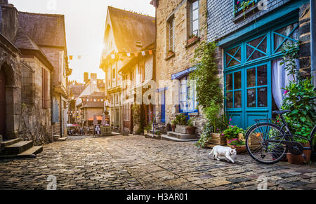 Enchanting old town in Europe at sunset with retro vintage filter effect
