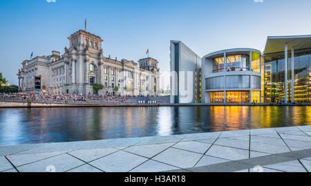 Classic view of modern Berlin government district with famous Reichstag building and Paul Lobe Haus in twilight, - Stock Photo