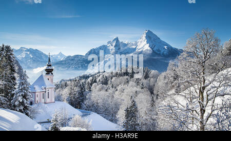 Idyllic winter wonderland in the Alps with pilgrimage church of Maria Gern and famous Watzmann mountain summit, - Stock Photo