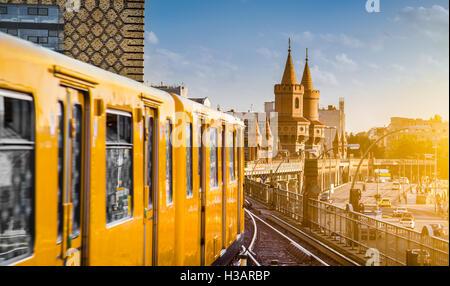 Panoramic view of historic Berliner U-Bahn with famous Oberbaum Bridge at sunset, Berlin Friedrichshain-Kreuzberg, - Stock Photo