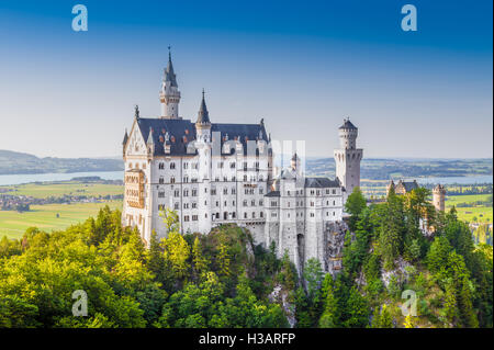 Classic view of world-famous Neuschwanstein Castle, one of Europe's most visited castles, at sunset, Bavaria, Germany - Stock Photo